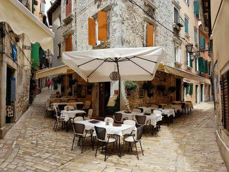 Cafe terrace in ancient town Rovinj, Croatia Europe