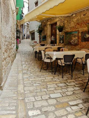 Cafe terrace in ancient street of Rovinj, Croatia Europe