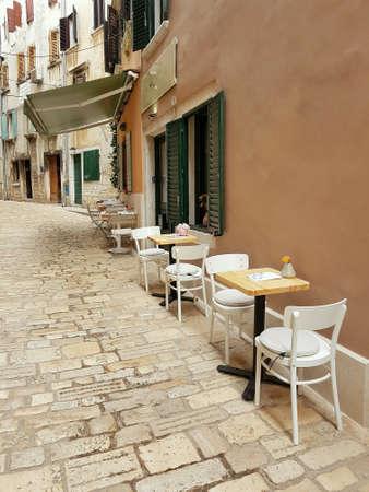 Bar terrace in narrow street of ancient Rovinj, Croatia Europe