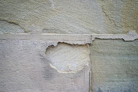 damaged: Old damaged stone wall background