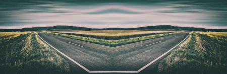 moody sky: Surrealistic mirrored road in a rural landscape setting
