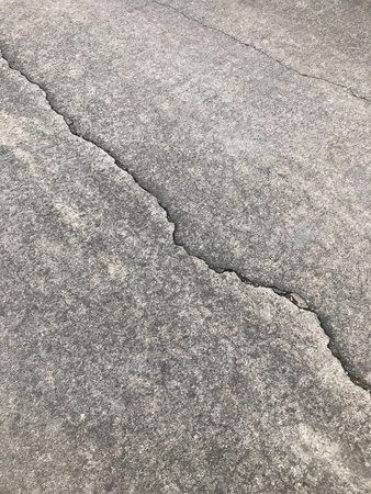 Asphalt road cracked and broken
