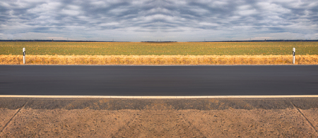Abstract highway road in front of an agriculture field Stock fotó
