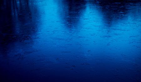 Frozen blue lake surface in winter