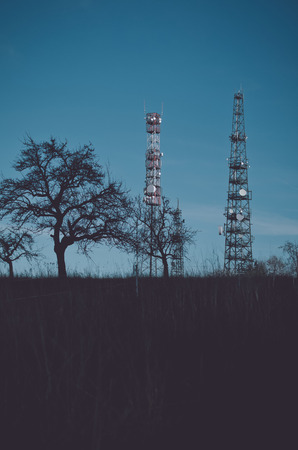 Two broadcasting towers on the meadow