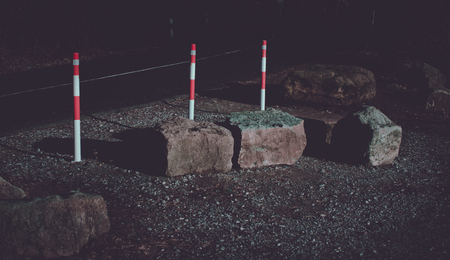 Barrier posts at the street Stockfoto