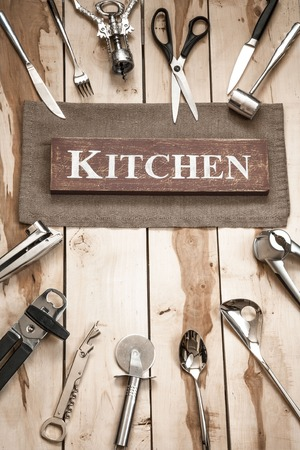backround: Professional kitchen tools on the wooden backround Stock Photo