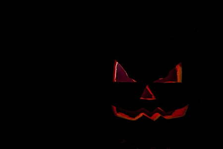 glowing carved: Halloween. Jack O Lantern on the black