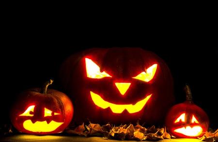 jack o   lantern: Halloween. Jack O Lantern on the black with leaves.