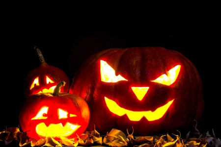 jack o: Halloween. Jack O Lantern on the black with leaves.