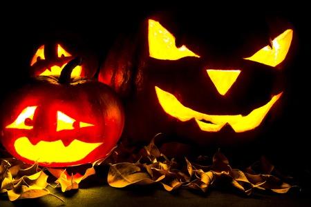 jack o' lantern: Halloween. Jack O Lantern on the black with leaves.