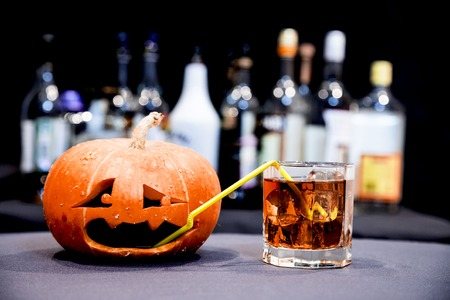 cocktails: Halloween party. Funny Pumpkin with a cocktail Stock Photo