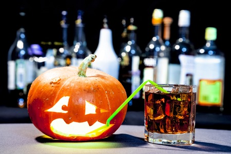 jack o: Jack O Lantern. Halloween party. Funny Pumpkin with a cocktail Stock Photo