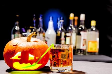 jack o' lantern: Jack O Lantern. Halloween party. Funny Pumpkin with a cocktail Stock Photo