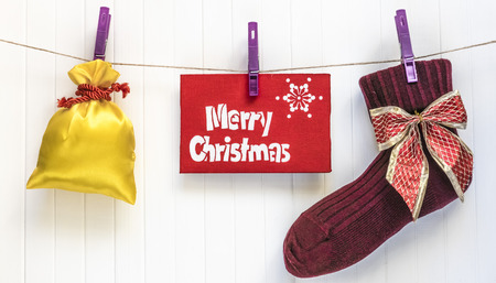 cristmas card: Merry Cristmas sock. Merry Cristmas and happy new year card with present.