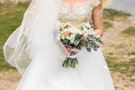 Brides bouquet on the nature.