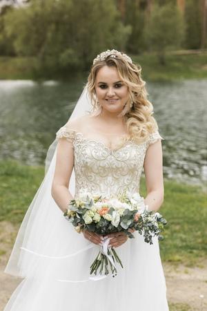 Wedding on the river bank. Happy bride Imagens
