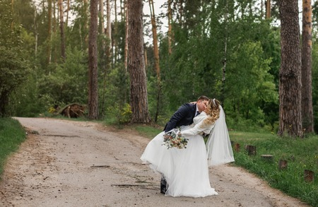 Wedding day. Newlyweds in the forest. Just married Foto de archivo