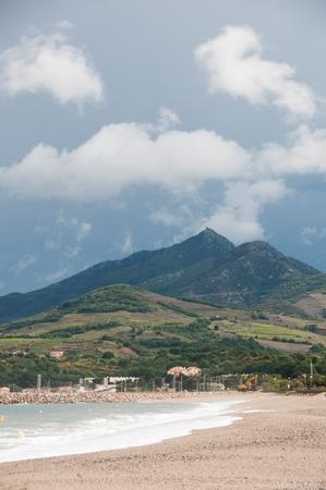 A beach with a mountain range