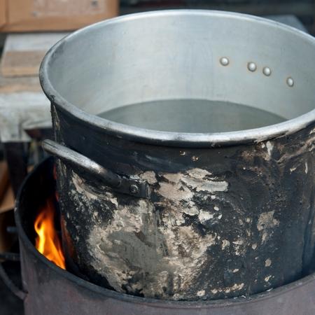 Aluminum pot on fire, Colonia Landivar, Guatemala City, Guatemala Imagens