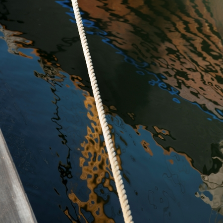 Boat reflection on rippled water, Skeppsholmen Island, Stockholm, Sweden