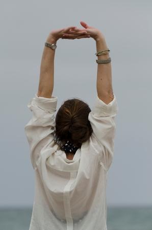 Woman stretching her arms, Sayulita, Nayarit, Mexico