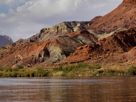 River with mountain range in the background, Glen Canyon National Recreation Area, Colorado River Float Trip, Colorado River, Arizona-Utah, USA 스톡 콘텐츠 - 97773177