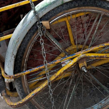 Rickshaw tied up with a chain and padlock, Colonia Landivar, Guatemala City, Guatemala
