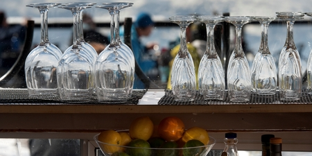 Empty wine glasses and champagne flutes at bar counter, Whistler, British Columbia, Canada Stock Photo