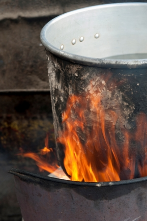Aluminum saucepan on fire, Colonia Landivar, Guatemala City, Guatemala