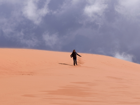 Person walking in a desert, Coral Pink Sand Dunes State Park, Utah, USA