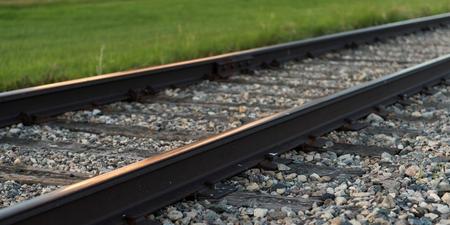 Railroad tracks passing through a prairie field, Manitoba, Canada Archivio Fotografico