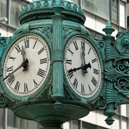 Low angle view of a clock on Marshall Field And Company, Chicago, Cook County, Illinois, USA