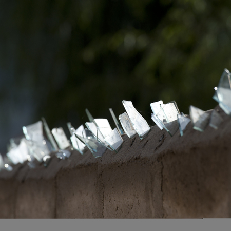 Jagged pieces of glass on the top of a wall in Thimphu, Bhutan