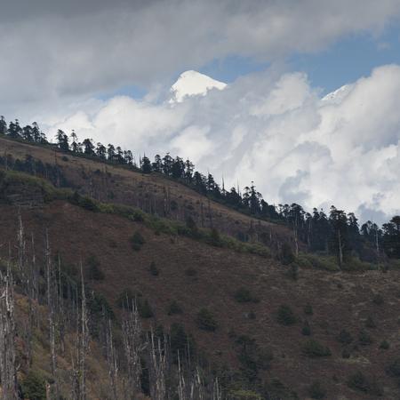 Clouds over a mountain, Bhutan