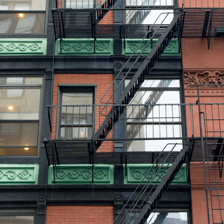Low angle view of fire escape on a building, SoHo, Manhattan, New York City, New York State, USA