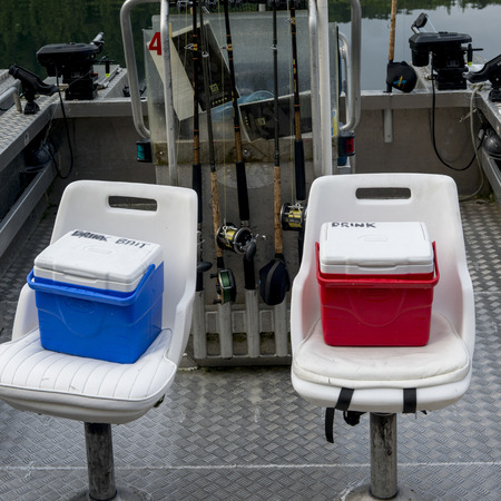 Coolers on the seats of Fishing boats at dock, Skeena-Queen Charlotte Regional District, Haida Gwaii, Graham Island, British Columbia, Canada 新聞圖片