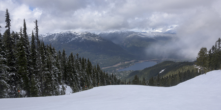 High angle view of lake with mountains in winter, Whistler, British Columbia, Canada