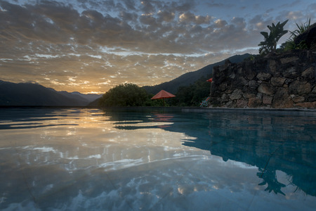 Infinity pool in tourist resort near mountains, Yelapa, Jalisco, Mexico