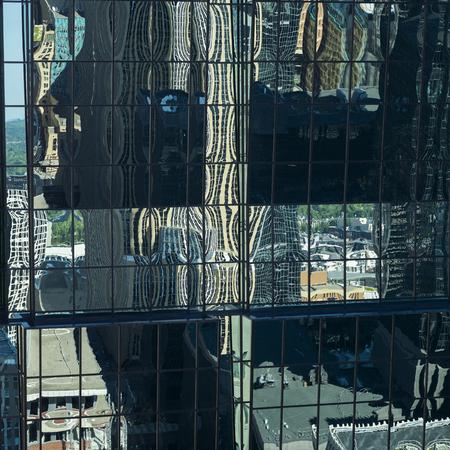 Reflections on modern glass building, Minneapolis, Hennepin County, Minnesota, USA