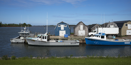 Fishing sheds and boats at dock, Green Gables, Prince Edward Island, Canada Stock Photo