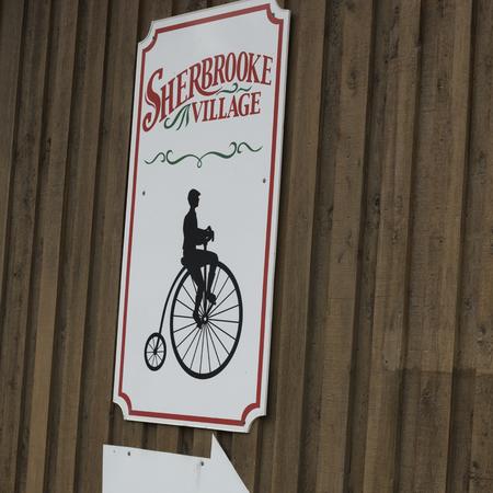 Sign on wooden wall, Sherbrooke, Nova Scotia, Canada Stock Photo