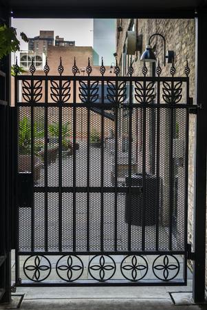 Closed gate amidst houses, Minneapolis, Hennepin County, Minnesota, USA