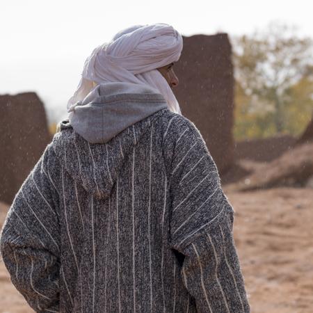 Rear view of a Tuareg man standing, Telouet, Ouarzazate, Souss-Massa-Draa, Morocco