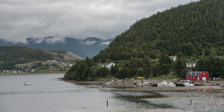 Town along the coast, Bonne Bay, Norris Point, Gros Morne National Park, Newfoundland And Labrador, Canada Stock Photo