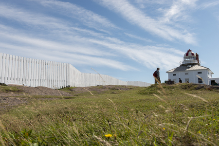 Tourists at Lighthouse, Cape Spear, St. John's, Newfoundland And Labrador, Canada