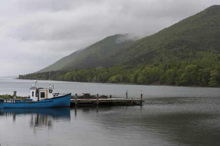 Fishing trawler moored at dock, Englishtown, Cape Breton Island, Nova Scotia, Canada
