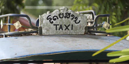 Close-up of taxi sign, Luang Prabang, Laos Stok Fotoğraf
