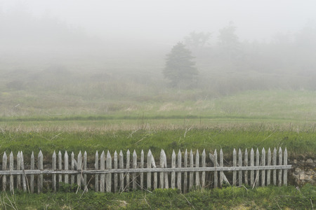 Fence in field during fog, Fortress of Louisbourg, Louisbourg, Cape Breton Island, Nova Scotia, Canada Reklamní fotografie