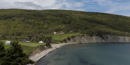 Scenic view of village at coastline, Cape North, Cape Breton Island, Nova Scotia, Canada 写真素材